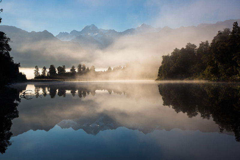 The fog began to lift and Lake Matheson reflected the Southern Alps beautifully on its calm waters.