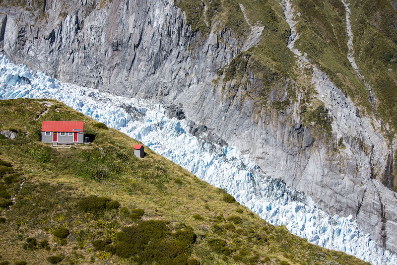 A mountain cabin and the essential outhouse next to Fox Glacier.