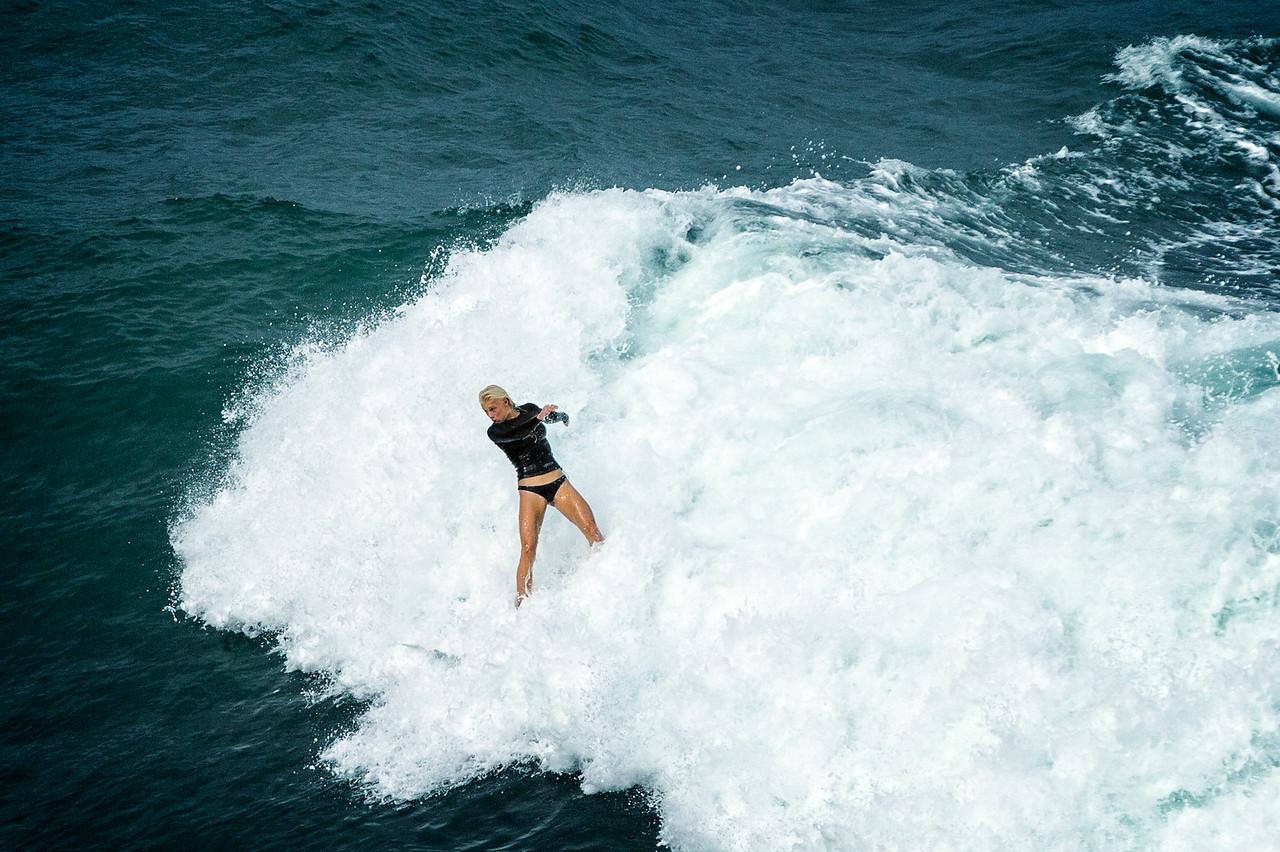 Surfing at Kalihiwai Bay