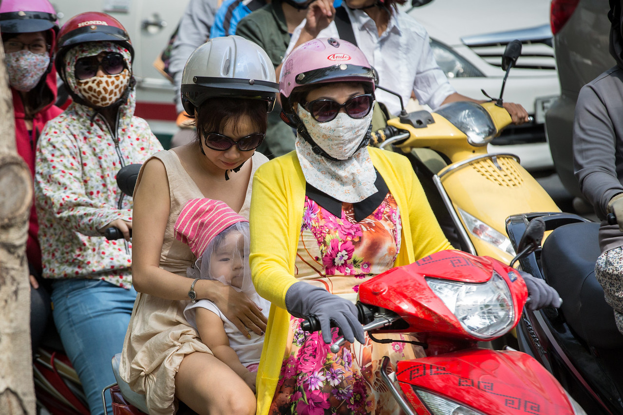 The motorscooter and motorcycle traffic, mixed in with bicycles, cars, and foot traffic made it scary to try to cross a street. As you can see, masks are commonly worn because of the pollution.