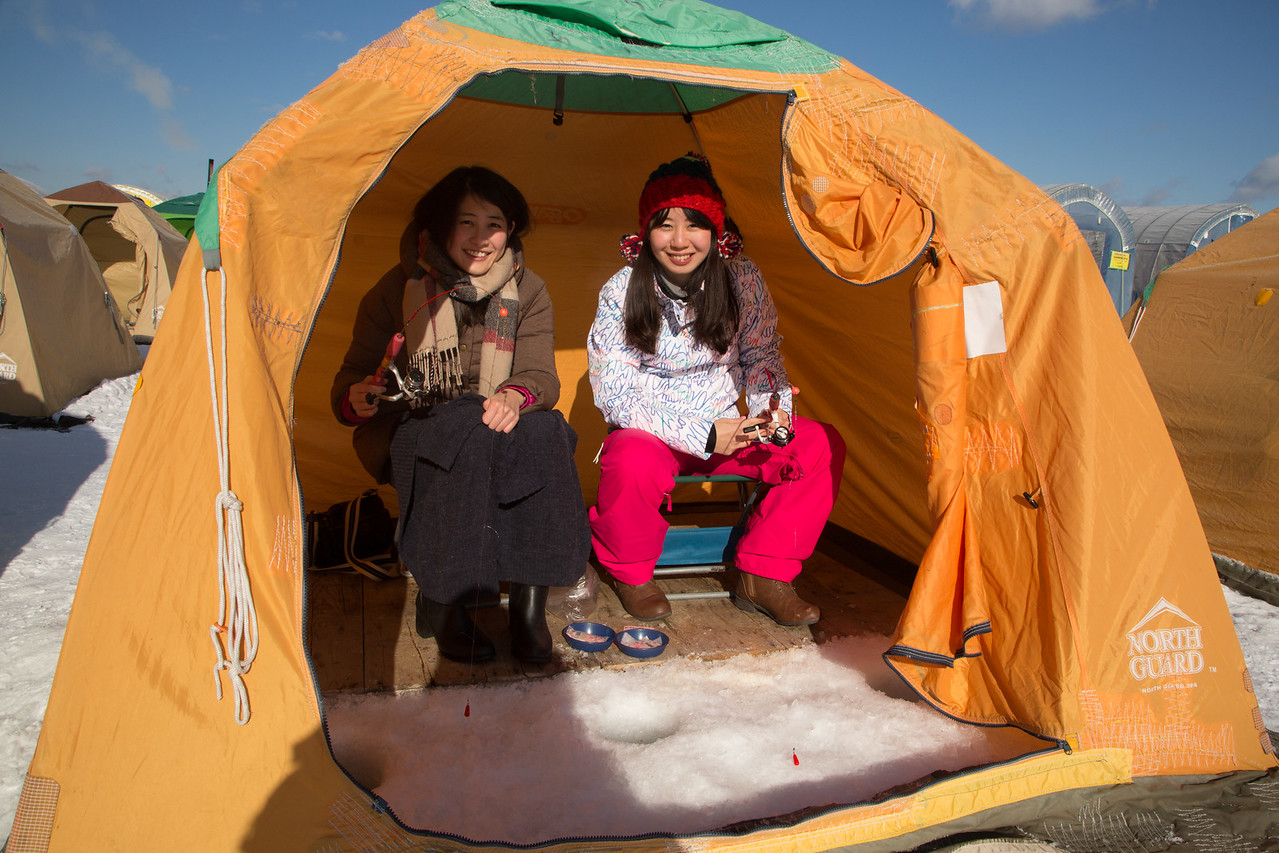 Young ladies ice fishing