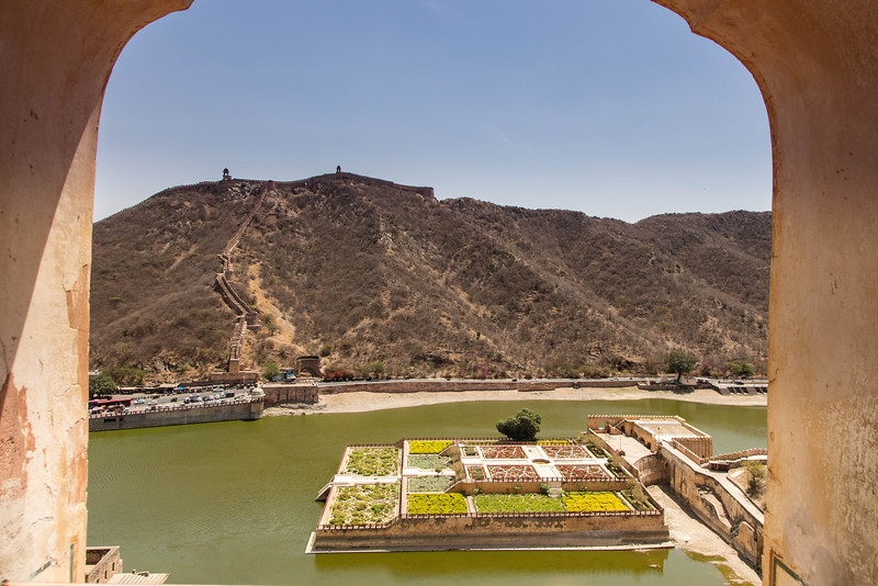 A view from Ameer Fort looking at an exterior gardens and the wall that surrounds the city of Jaipur.