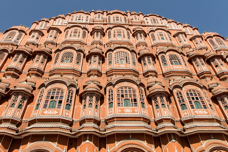 the building is the Hawa Mahal in Jaipur, built in 1799 to permit the women of the royal family to observe street parades without being seen from the outside. Hmmm!