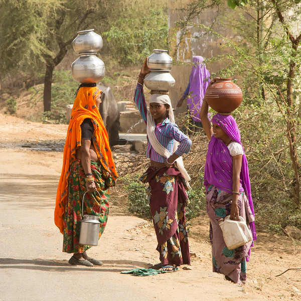 Women carrying water from a nearby well.