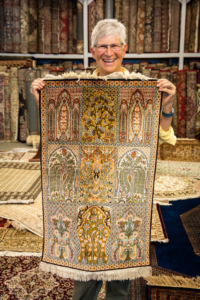 Julie proudly holding the carpet we purchased which has 2000 individuallly tied silk knots per square inch of carpet. It took months to make.