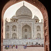 Th Taj from an adjacent building archway.
