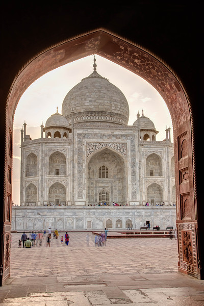 Th Taj from an adjacent building archway.