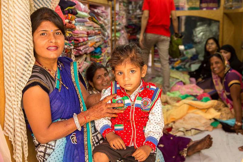 Mother and daughter looking at sarees.