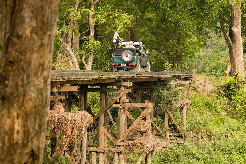 This is the type of jeep we traveled in with the lead one crossing an old bridge.