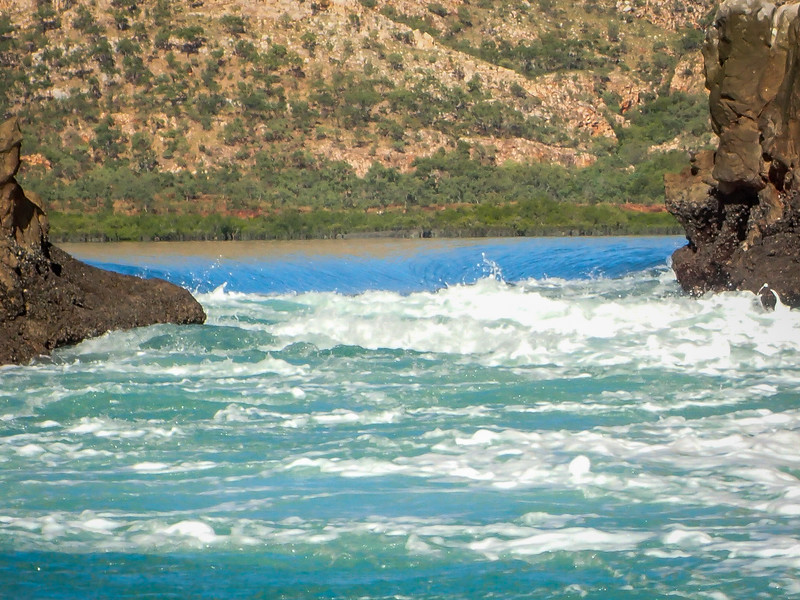 Look close to see the wall of water built up behind the opening (Horizontal Falls as they call it) as it pushes to get out when the tide recedes.