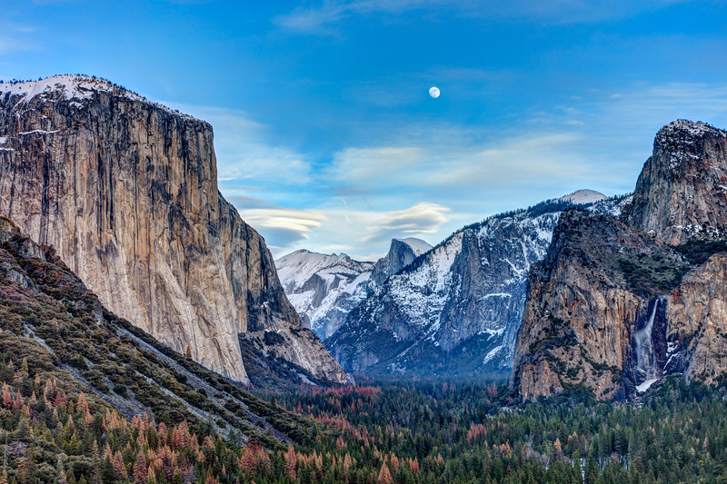 Rising moon with lenticular clouds over Yosemite Valley