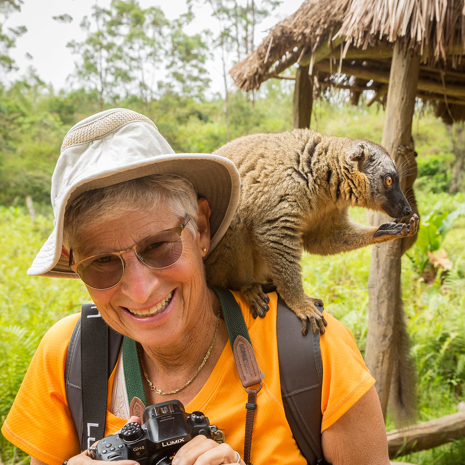 Julie getting more comfortable with a lemur on her shoulder