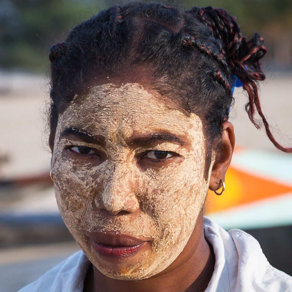 Women paint their faces with a mud to protect their skin from the sun.