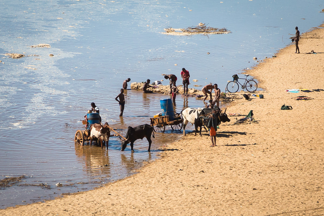 Life along the river: fetching water, bathing, and washing clothes.