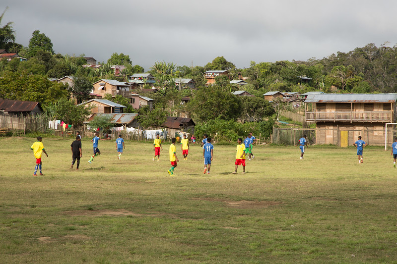 Formal soccer game for which much of the community attended.