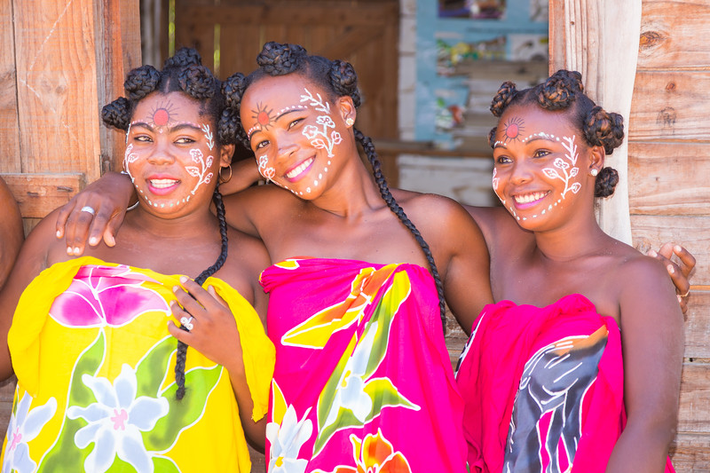 Women paint their faces and wear colorful dresses for occasions as part of their cultural traditions.