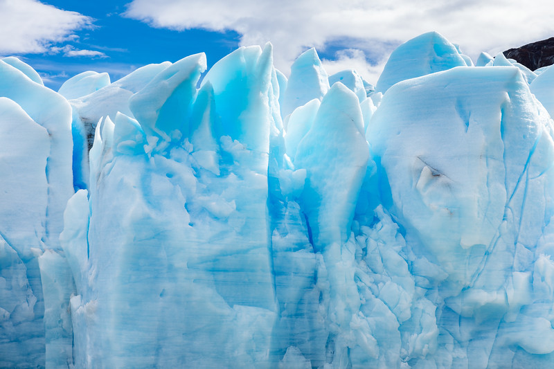 Glacial ice is so blue because the dense ice of the glacier absorbs every other color of the light spectrum except blue.
