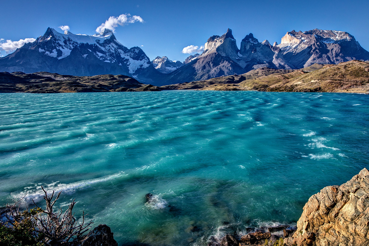 Another view of the Paine Massif from Lake Pehoe. Why is the water so blue? The silt created by the movement of the glacier creates what is called rock flour which is suspended in the water. The light reflecting on the rock flour creates the beautiful blue-green color.