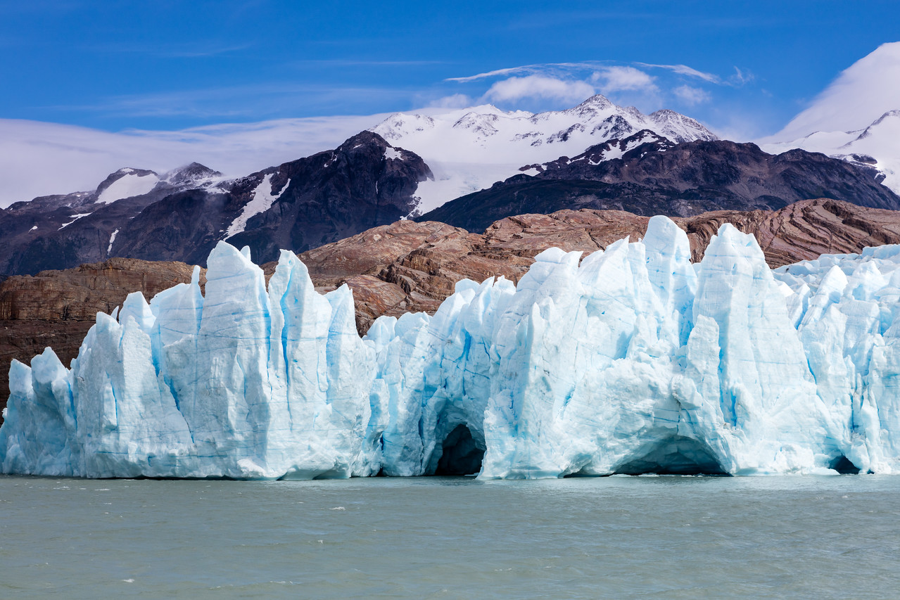 Observe how the movement of the glacier has carved away the granite behind it.