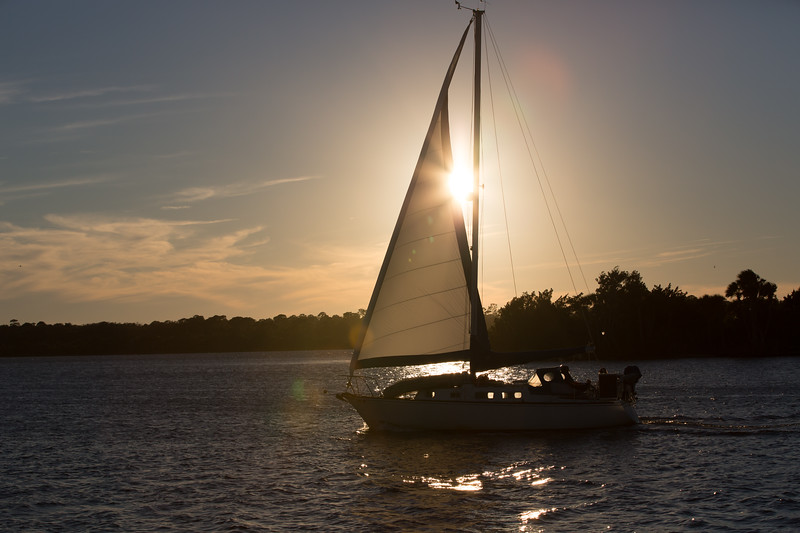 Sailboat passing by the house