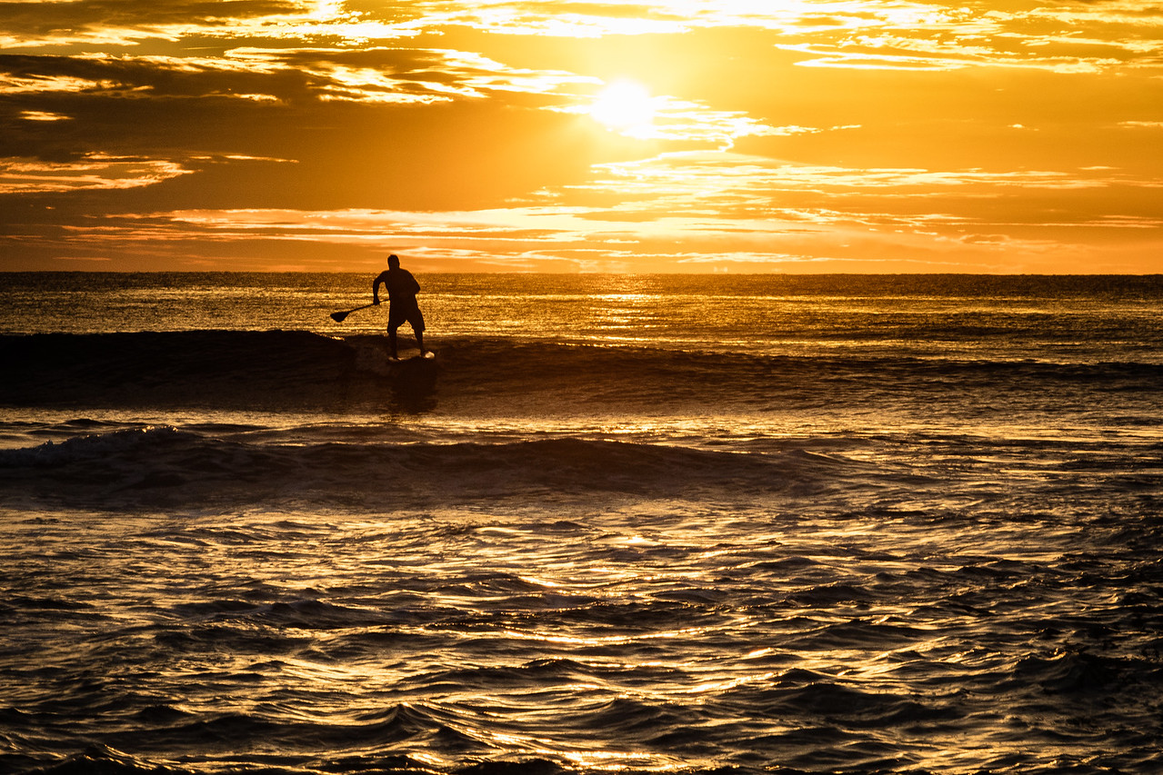Paddleboarder early in the morning