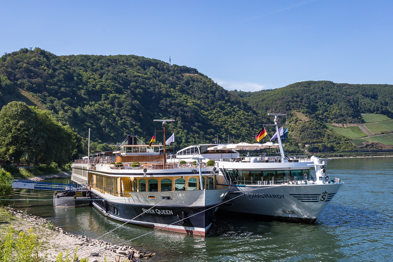 River cruises have become so popular that often there are not enough places to dock along the banks so boats dock as shown and passengers disembark by walking through the first ship.