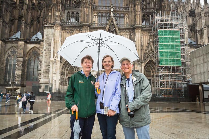 Julie and shipmate-friends, Patty an Margie,  standing in front of the famous Cologne Cathedral.