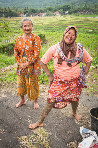 This delightful woman was showing us her muddy legs from working in the rice fields.