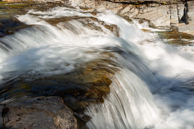Listening to the sound of the fast flowing water making  its way to Lake McDonald.