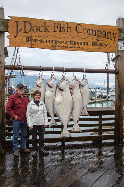 A proud couple with their catch of the day