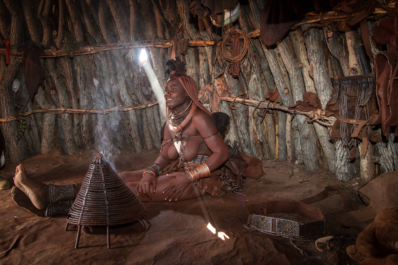 We were invited into a hut to learn more about Himba life