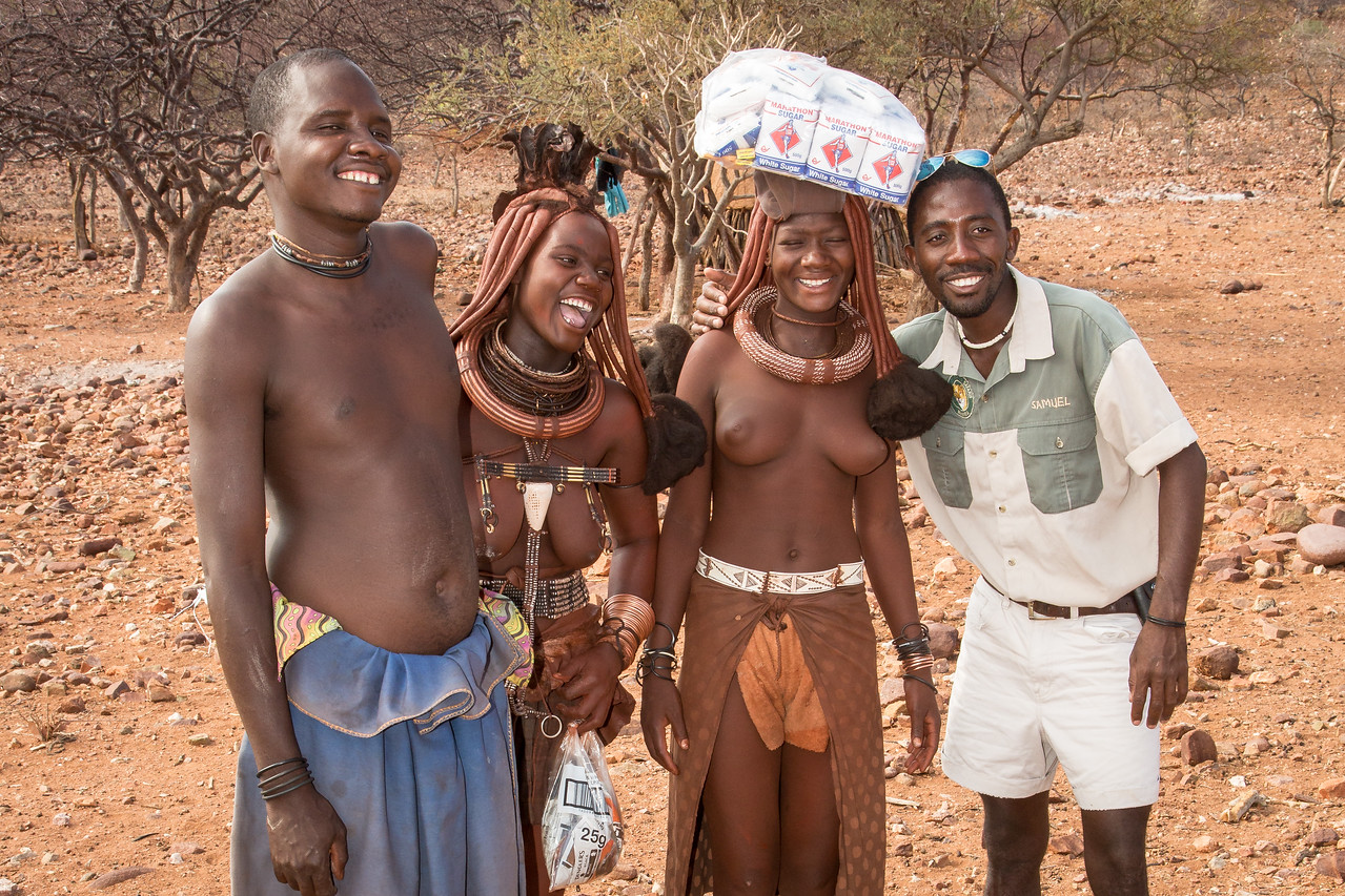 Back in the village we gave them salt, sugar, maize, and razor blades. Our Himba guide is on the right
