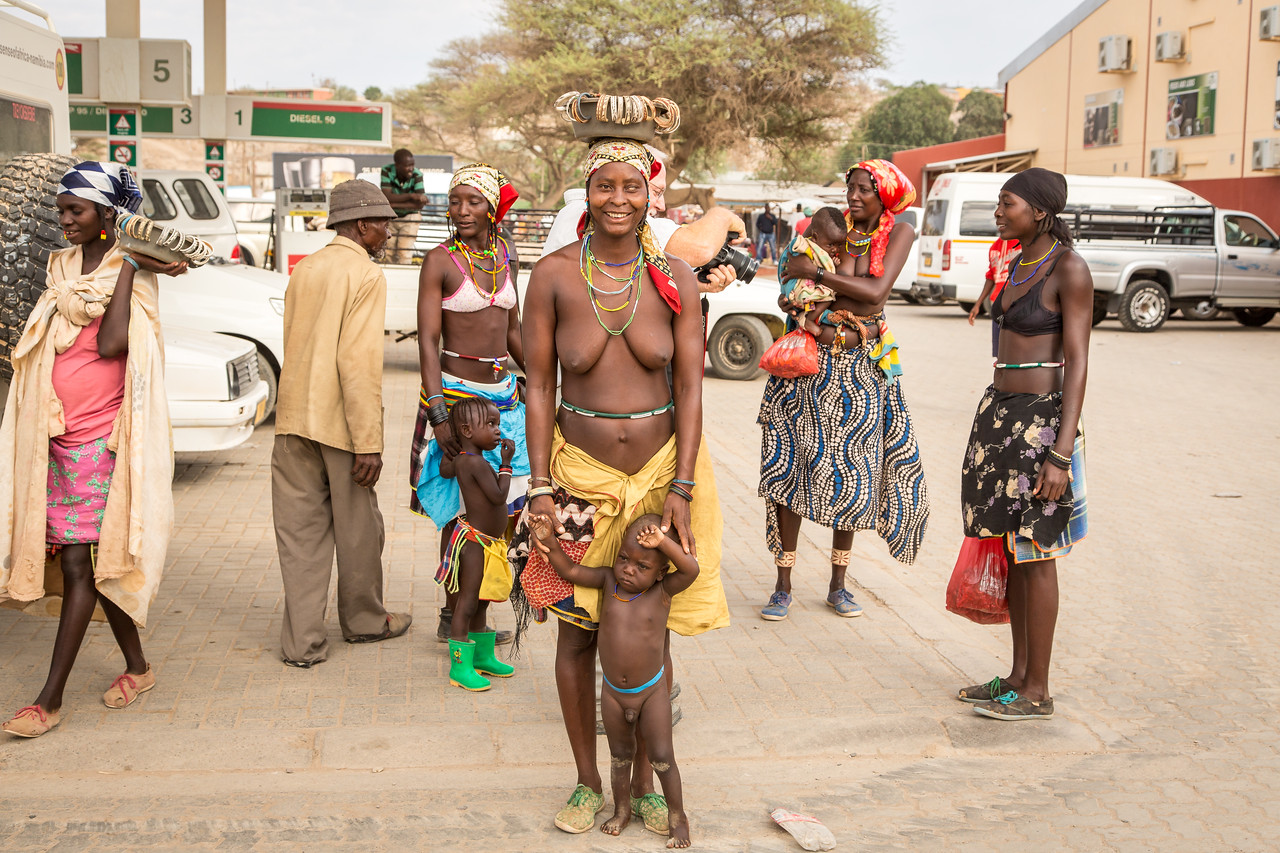 Himba interact with the local urban culture as seen here in Opuwo. They shop at the supermarket and sell their crafts