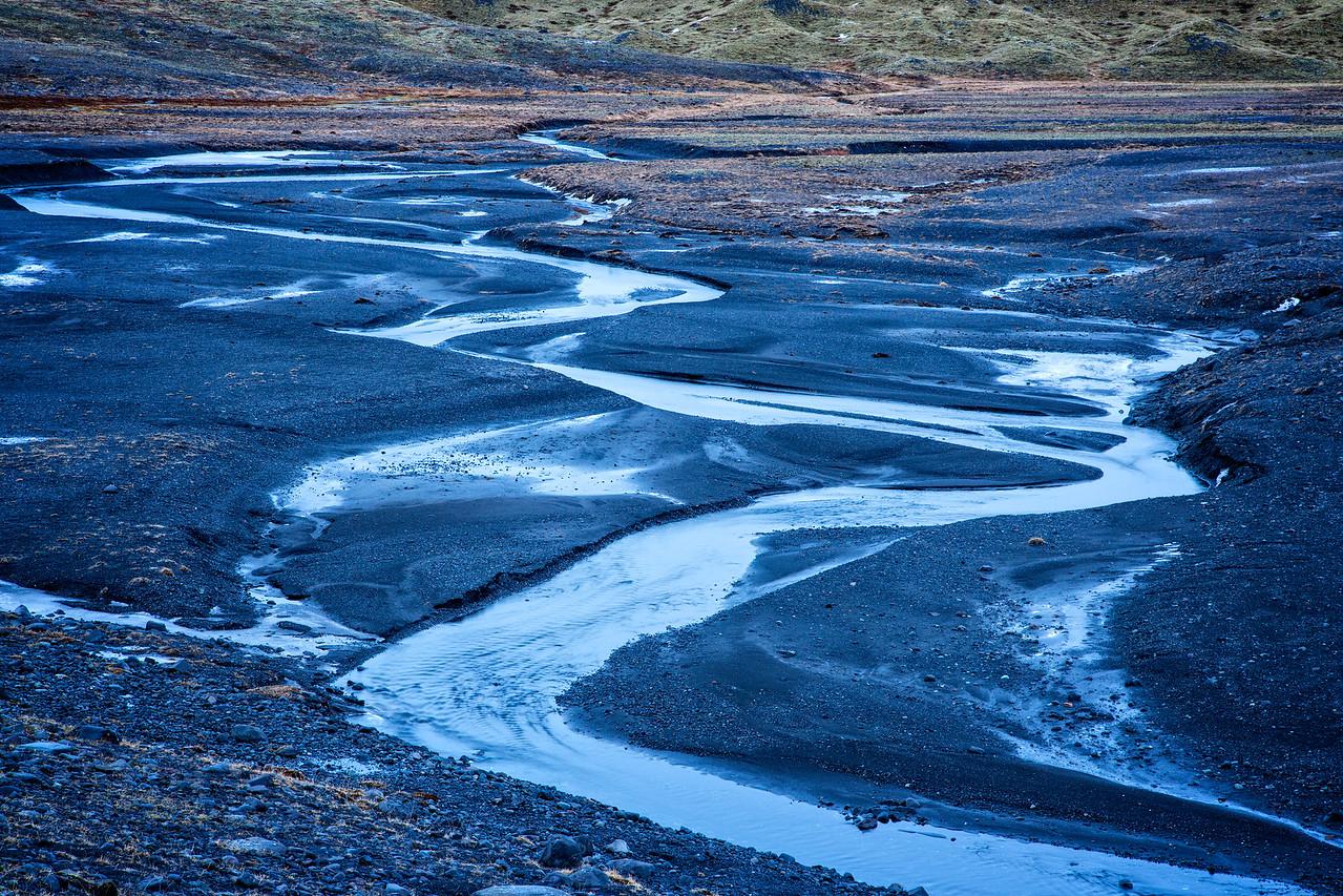 Meandering stream through the moraine of Vatnajokull Glacier