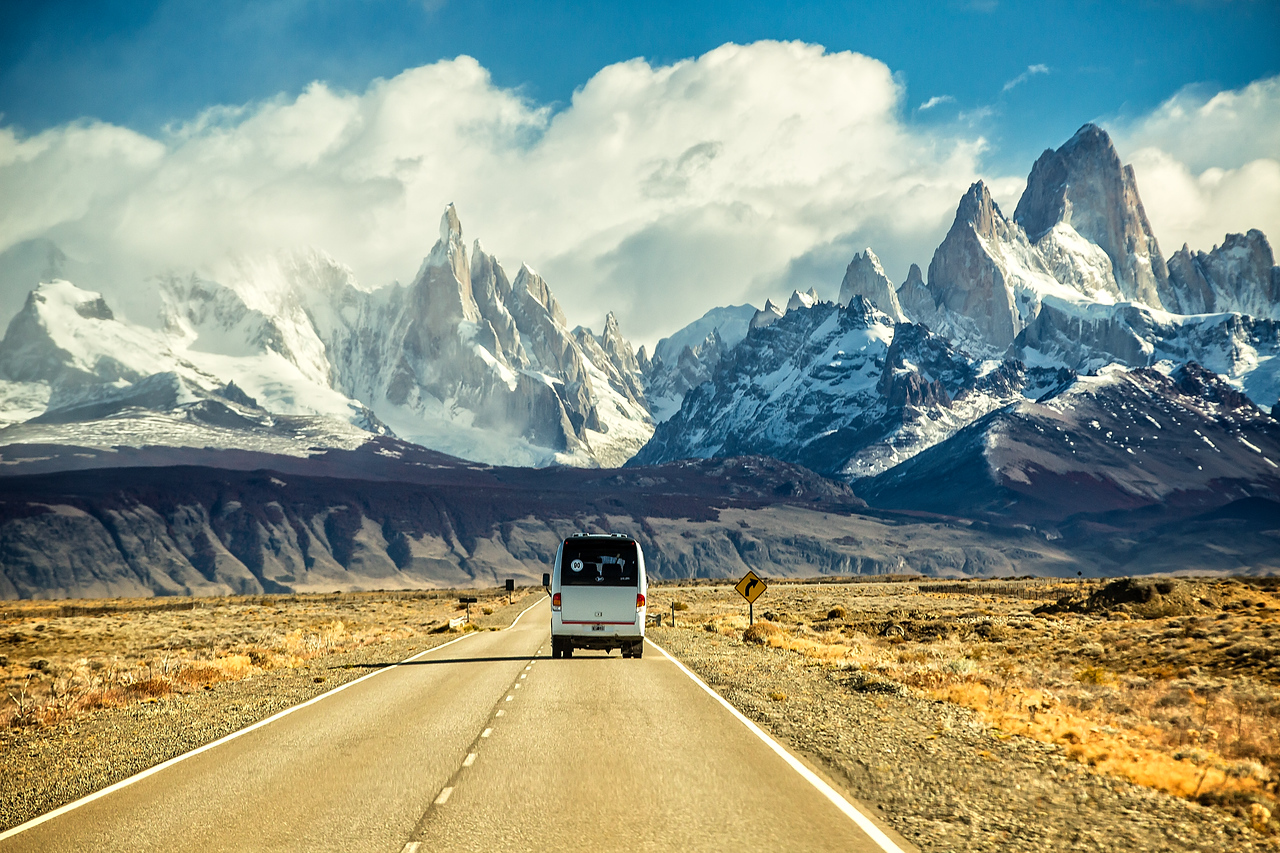 We had been traveling for several hours in our two buses crossing the high desert plains east of the southern Andes. It's not much to look at, but then in the far horizon we began to see Fitz Roy.  After driving another 30 miles we had this impressive view taken from the moving bus.