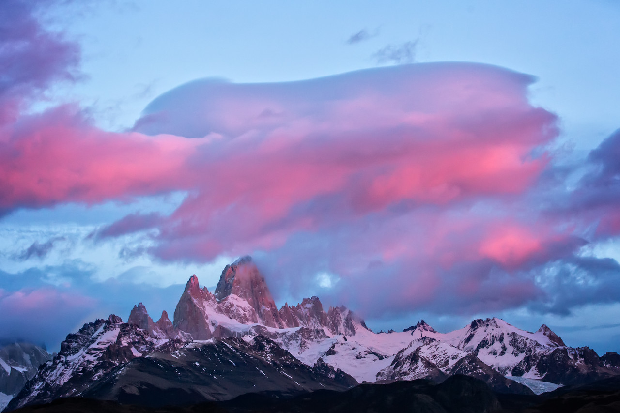 The sun cast its warm glow on the clouds above Fitz Roy. It was magical.