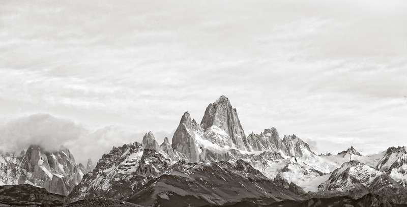 We stayed at the site for another hour hoping for another burst of sunlight on the mountains, but the clouds only grew thicker. So, with the clouds creating soft, even light, I made this monochromatic photo.