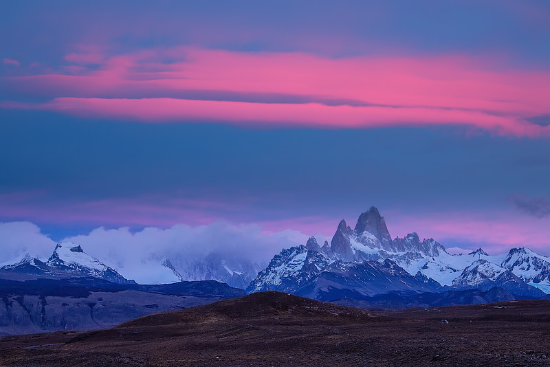 Several mornings we arose well before dawn to drive back to the location where we photographed Fitz Roy Chalten when we first arrived. We sat on the bus for about 30 minutes waiting for the light. It was bitterly cold and windy, but then this soft pink began to appear over the mountain and we hustled out of the bus with our tripod-mounted cameras to capture this scene.