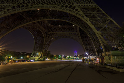 Under the Eiffel Tower without crowds (very early in the morning).