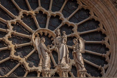 Statue of Mary and Jesus with angels on either side