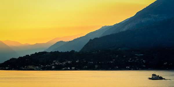 A ferry makes its way across Lake Como, Italy