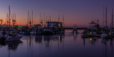 Fishing boat headed out at dawn