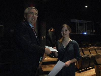 Tinley Park-Frankfort Rotary Club Treasurer Sean Brady presents a $500 scholarship to Jessica Anderson, a senior at Lincoln-Way East High School.