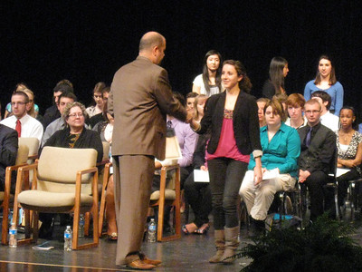 Lincoln-Way East High School Principal Scott Tingley congratulates Gina Ruvoli, one of the Top 10 students from Lincoln-Way East High School during a recognition ceremony March 12. The ceremony was organized by the Tinley Park-Frankfort Rotary Club.