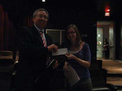 Tinley Park-Frankfort Rotary Club Treasurer Sean Brady presents a $500 scholarship to Rebecca Dalrymple, a senior at Andrew High School.