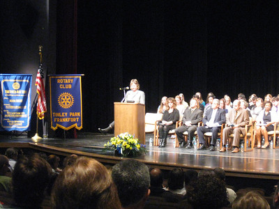 Karen Wegrzyn, president of the Tinley Park-Frankfort Rotary Club, welcomes students and parents to the service club's 22nd annual Top Ten Gala honoring the top 10 percent of students from Andrew, Tinley Park, Lincoln-Way East and Lincoln-Way North high schools.