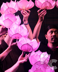 Water Puppeteers Holding Lotus Lights