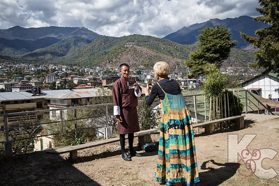 Masha Snaps a Photo of Kesang With Her Brochure