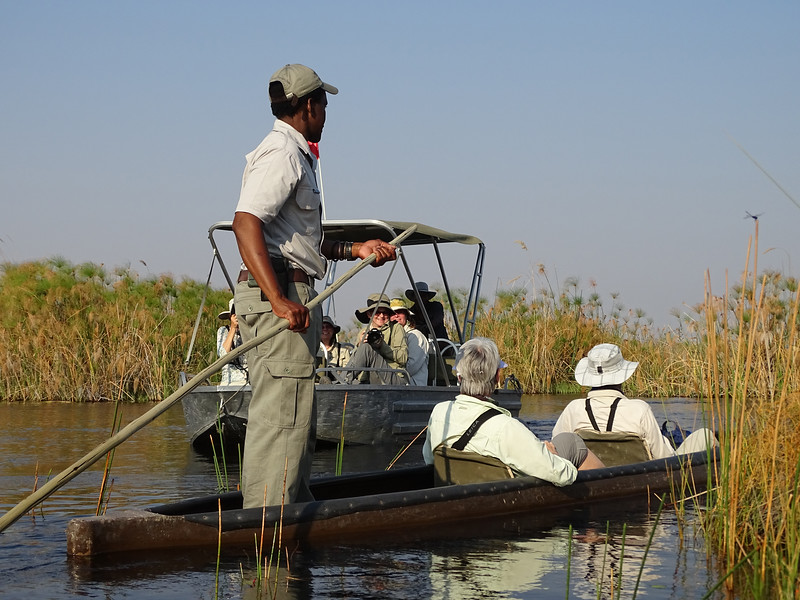 Mokoro Riders Passing Motorized Boat As We Cruised Along The Okavango Delta, Another UNESCO World Heritage Site