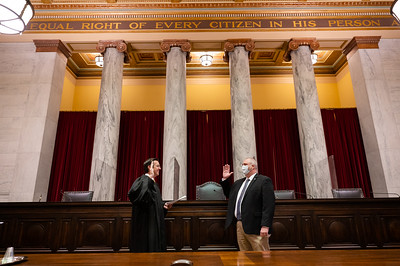 Supreme Court of Appeals of West Virginia Chief Justice Evan Jenkins swears in GE McCabe (white mask) as director of the Division of Emergency Management and Greg Fuller (black mask) as Deputy Director of the Division of Emergency Management in the WV Department of Homeland Security.  May 3, 2021.  (J. Alex Wilson - Supreme Court of Appeals of West Virginia)